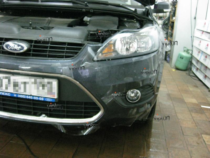 Автомобиль Ford Focus.  /  Нанесение антигравийной пленки 4